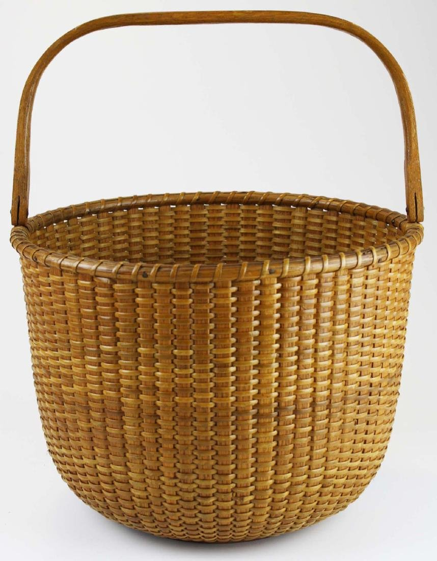 S P Boyer labeled Nantucket swing handled basket
