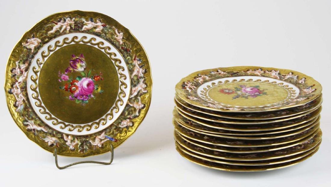 set of 12 old Capo di Monte plates w/ cherub border