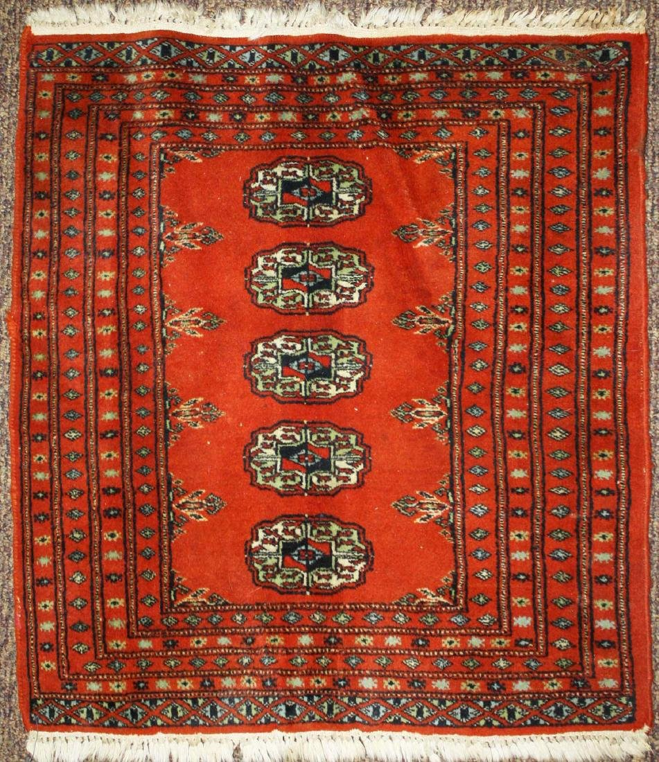 mid 20th c Tekke scatter rug, one row of 5 guls