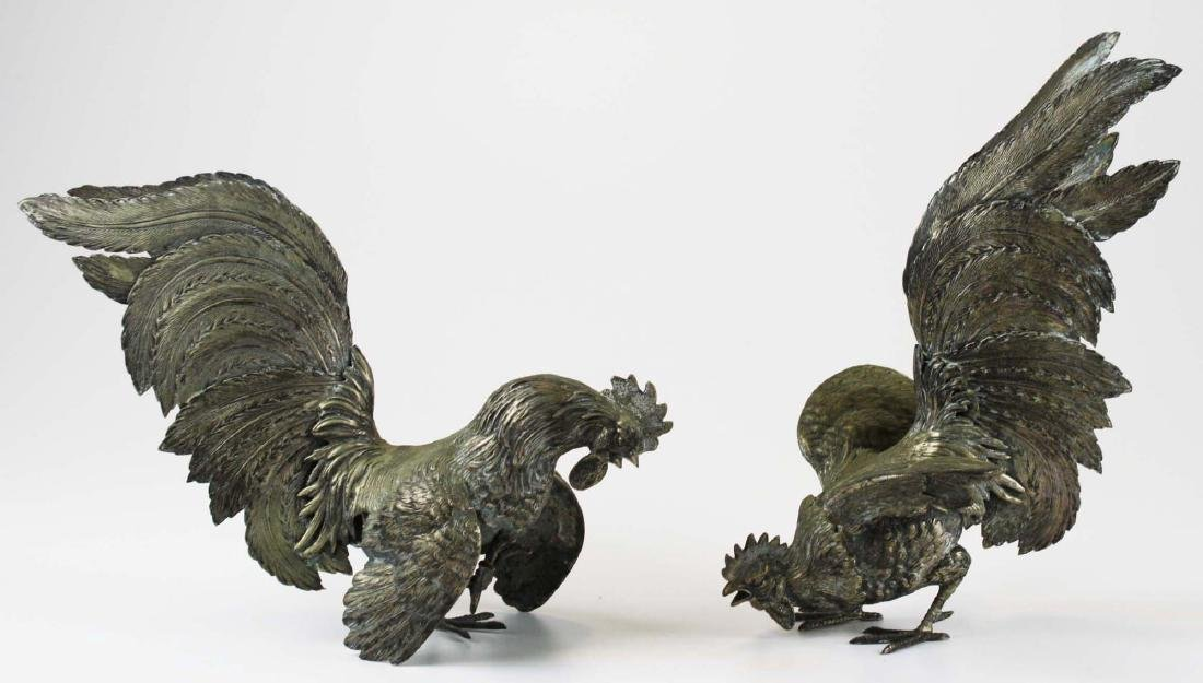 finely detailed silver fighting rooster figures