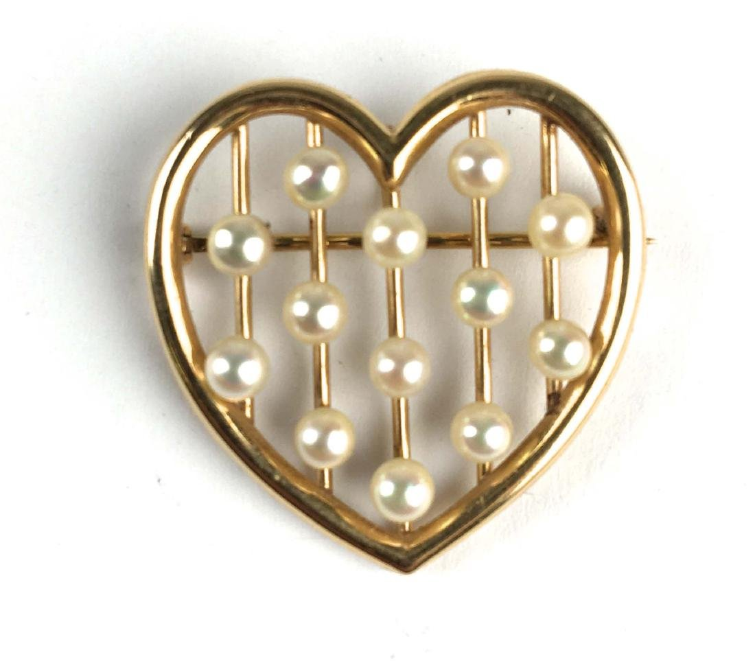 14k yellow gold and pearl heart pin brooch.