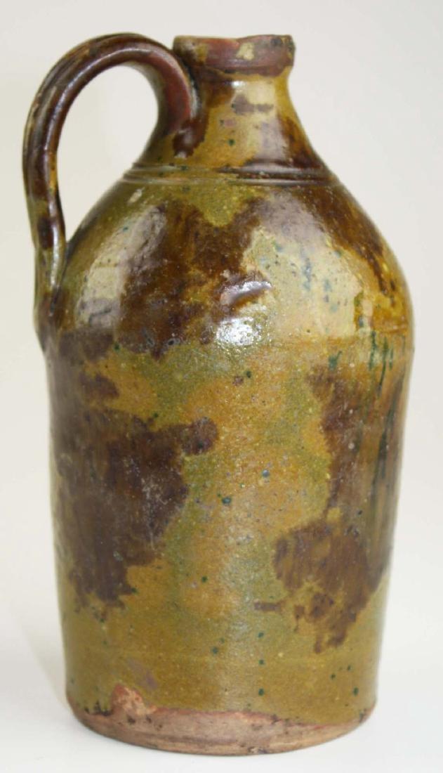 early 19th c redware jug w/ mottled glaze