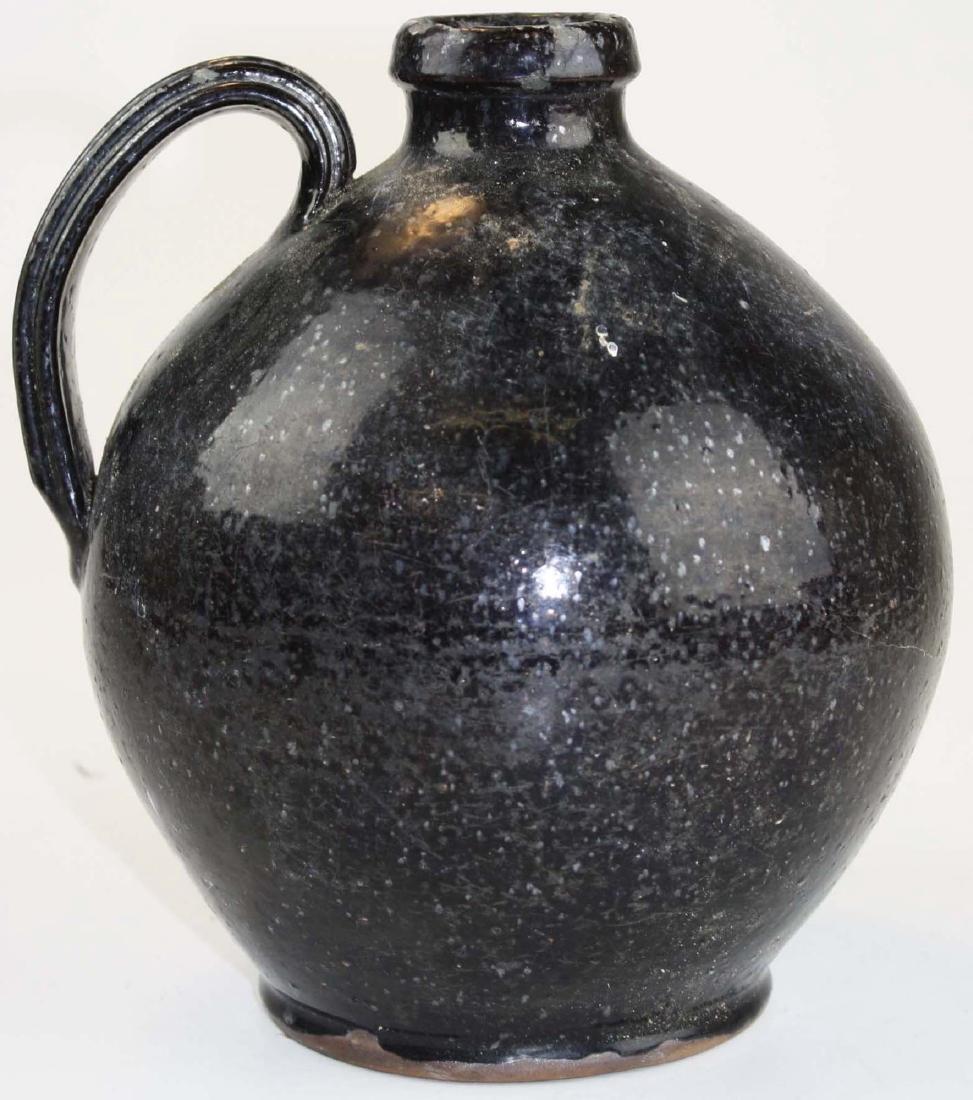 early 19th c redware ovoid jug w/ black glaze