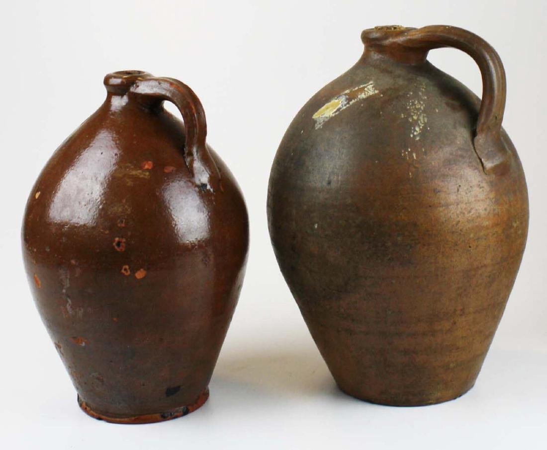 2 early 19th c one gallon redware ovoid jugs
