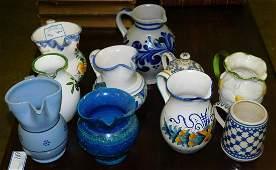 8 pottery pitchers, mug and ewer set