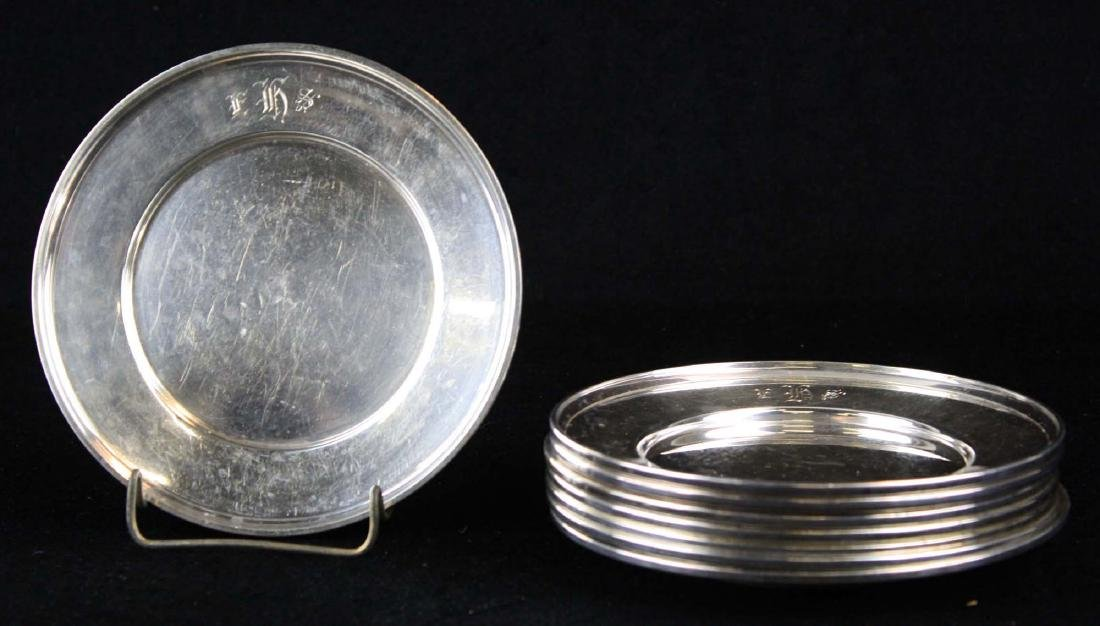 set of 8 Sterling silver plates or bread plates