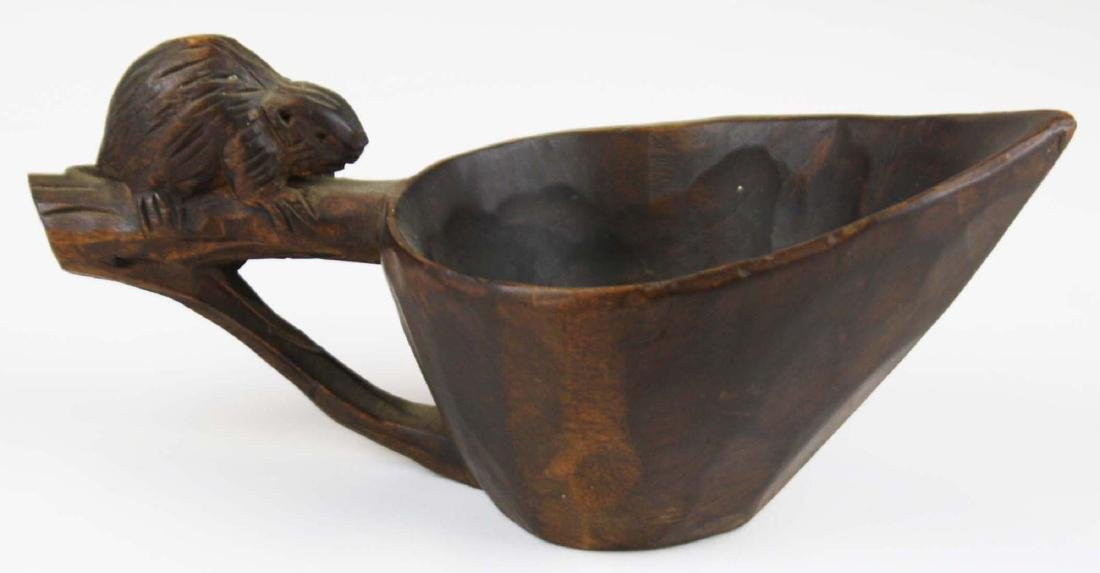 early 20th c voyageur canoe cup w/ beaver