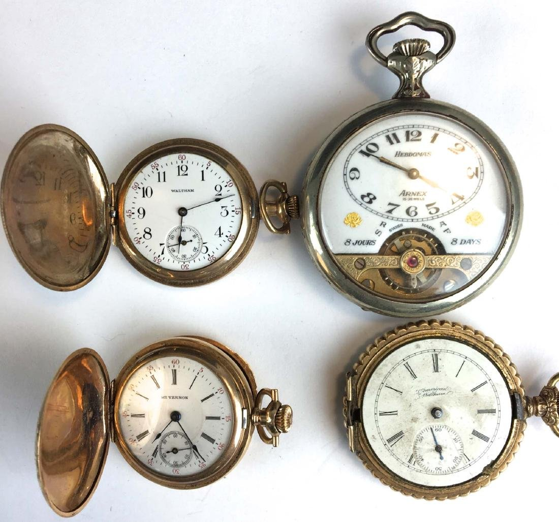 Group of 4 pocket watches.