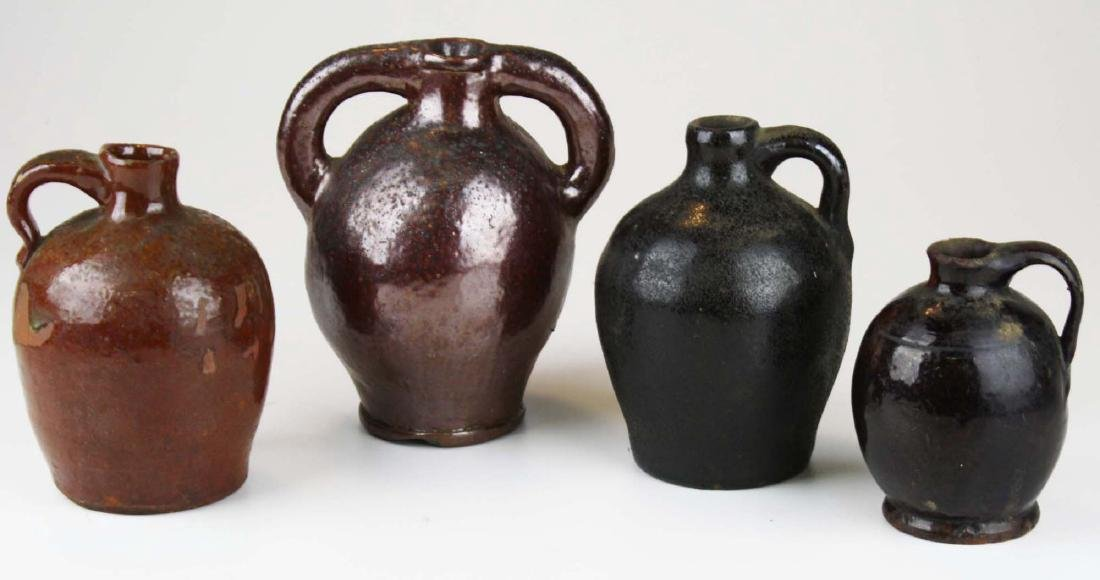 4 small early 19th c stoneware ovoid jugs