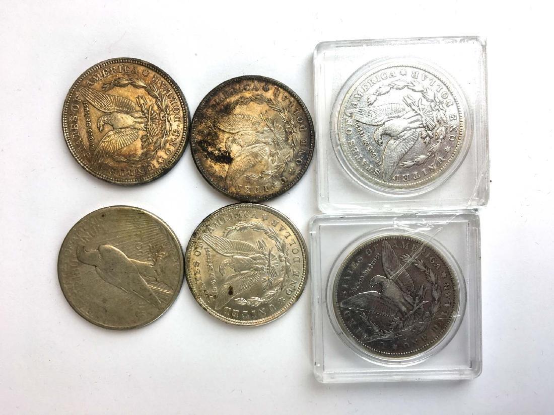 6 US silver dollars