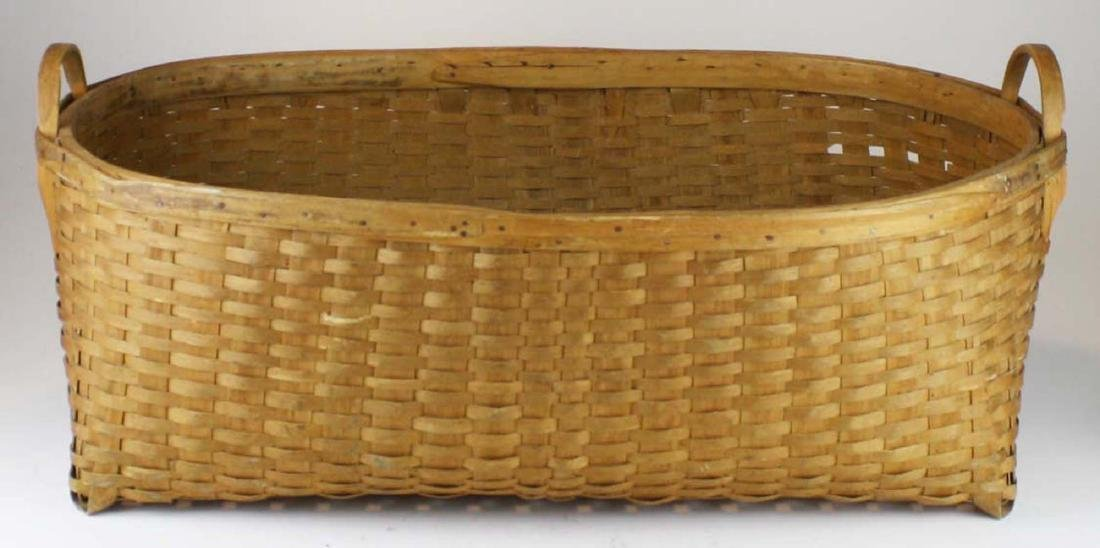 early 20th c double handled laundry basket
