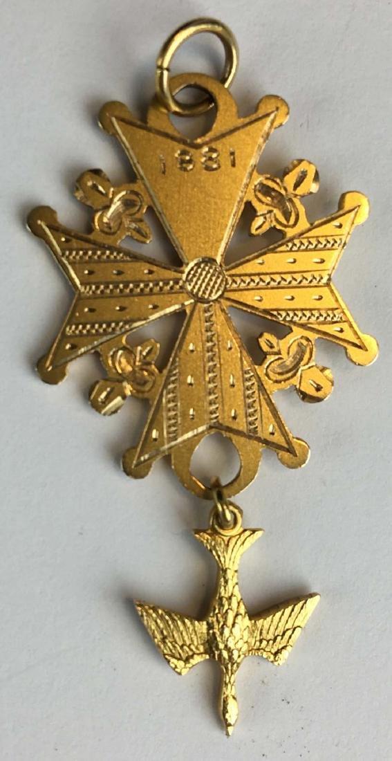 14k yellow gold pendant with bird