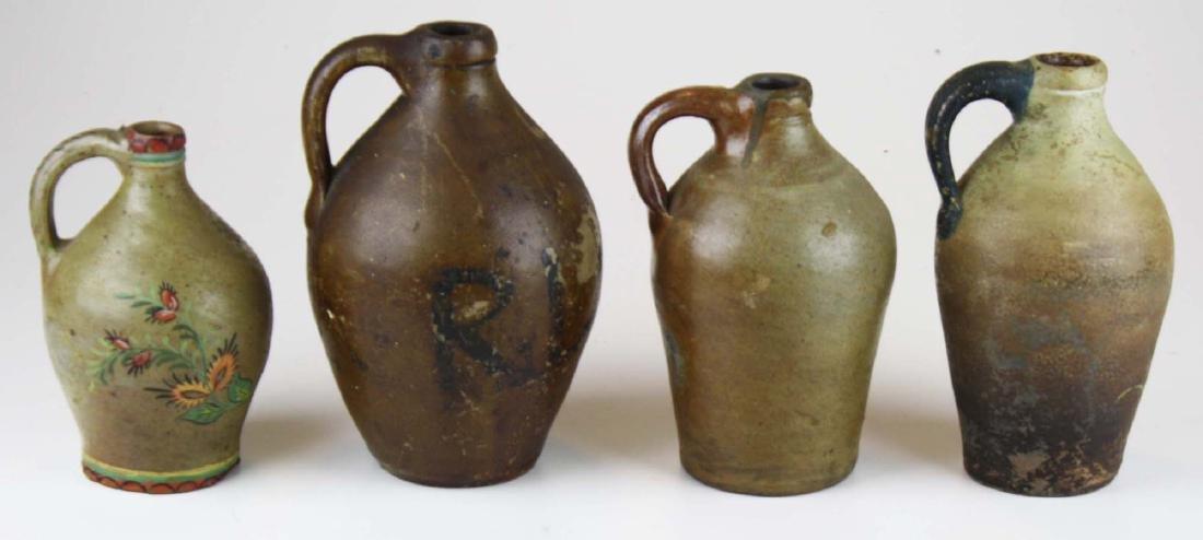 4 small early ovoid stoneware jugs
