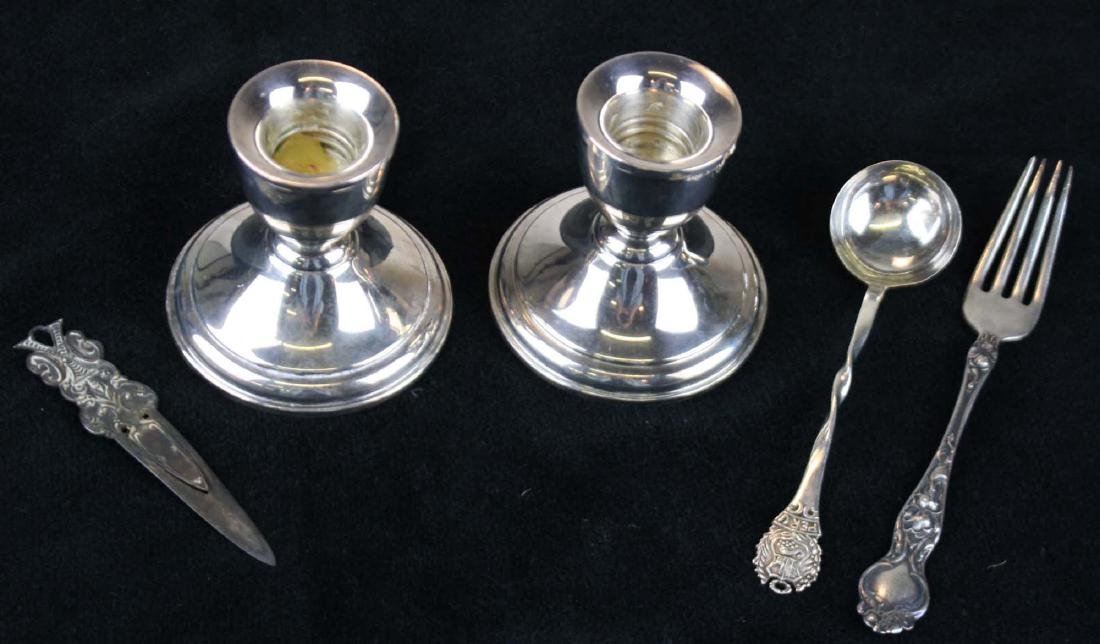 pr of weighted sterling silver  candlesticks