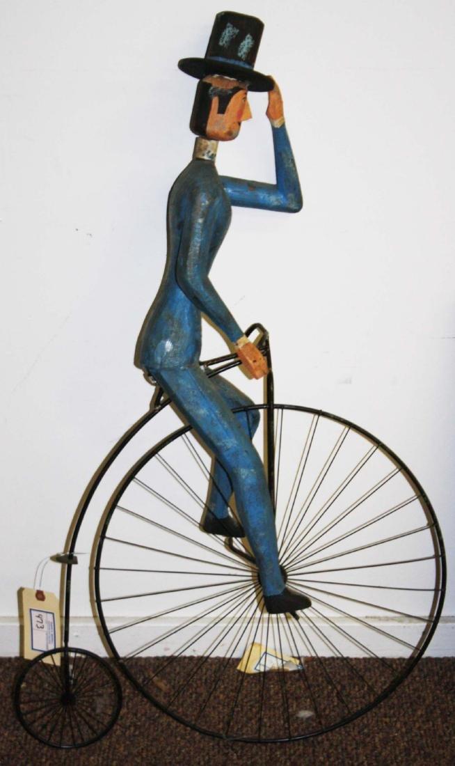 late 20th c folk art man on high wheel bicycle