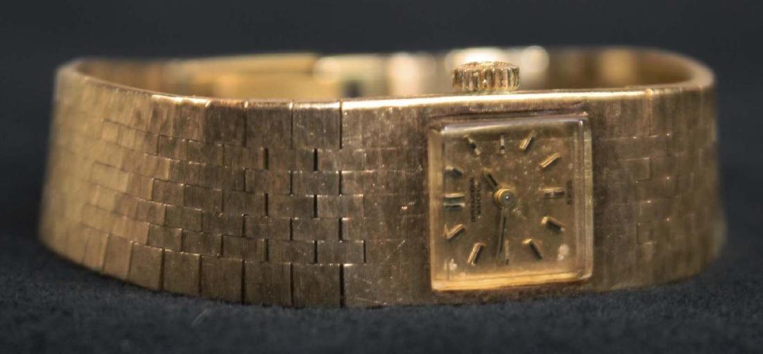 International ladies gold wrist watch