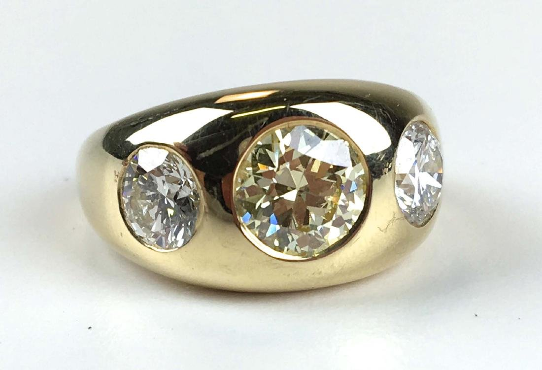 3 stone ring with fancy yellow 1.62 ct diamond