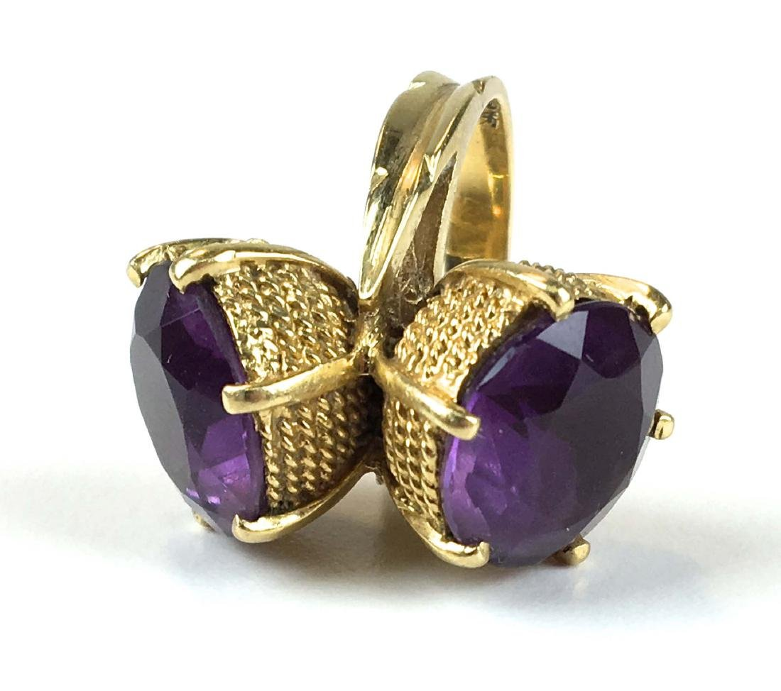 18k y.g ring with two large round cut amethyst.