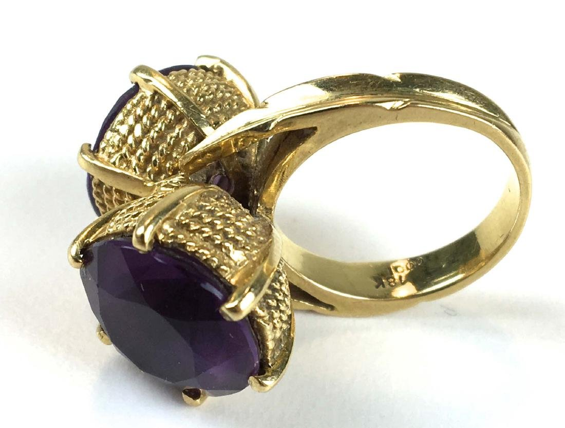 18k y.g ring with two large round cut amethyst. - 2