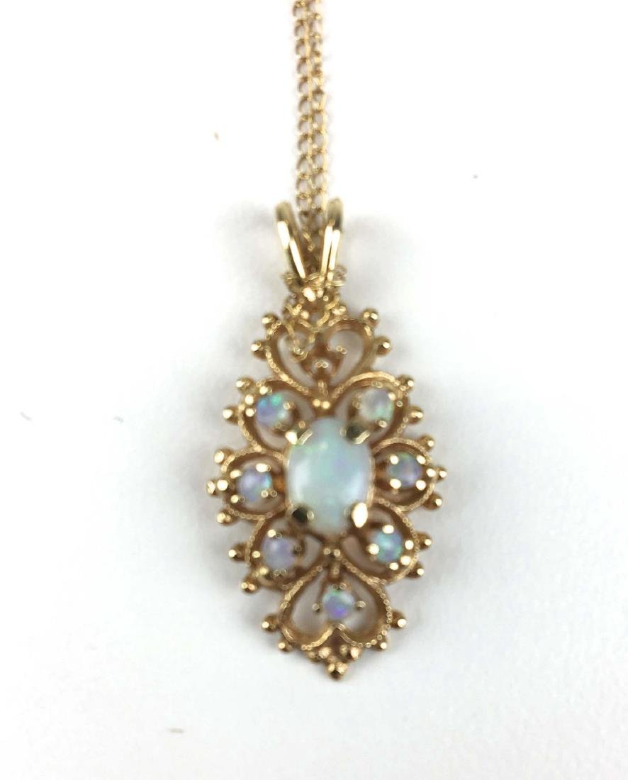 14k yellow gold and opal pendant.