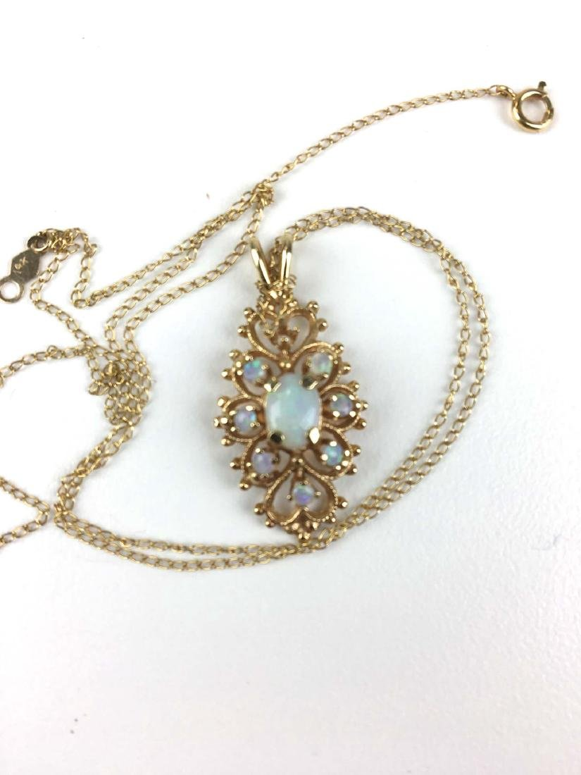 14k yellow gold and opal pendant. - 2