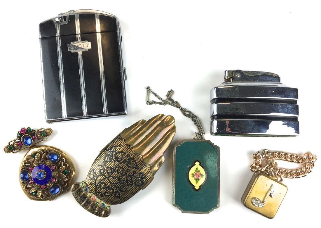 Group of vintage compacts and lighter.