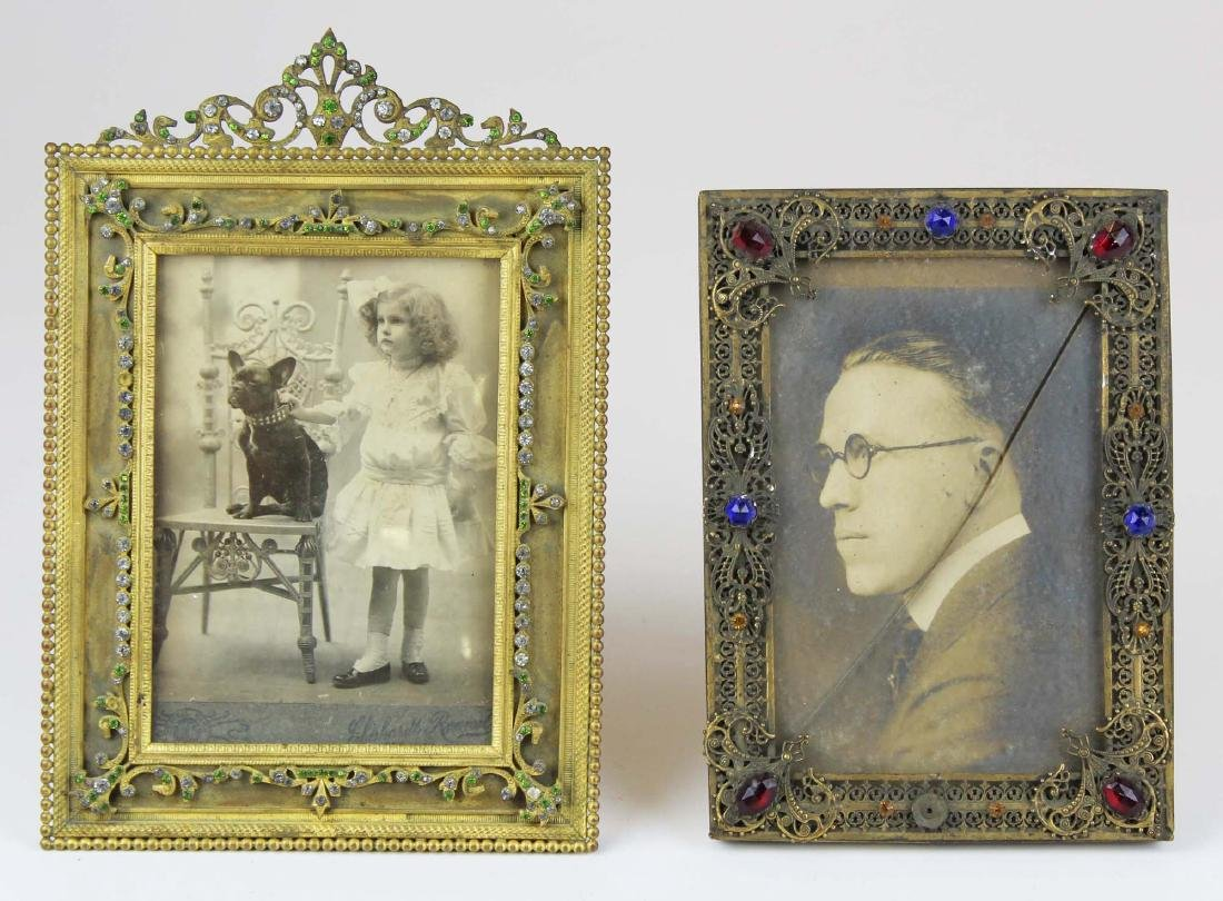 two gilt brass jeweled frames