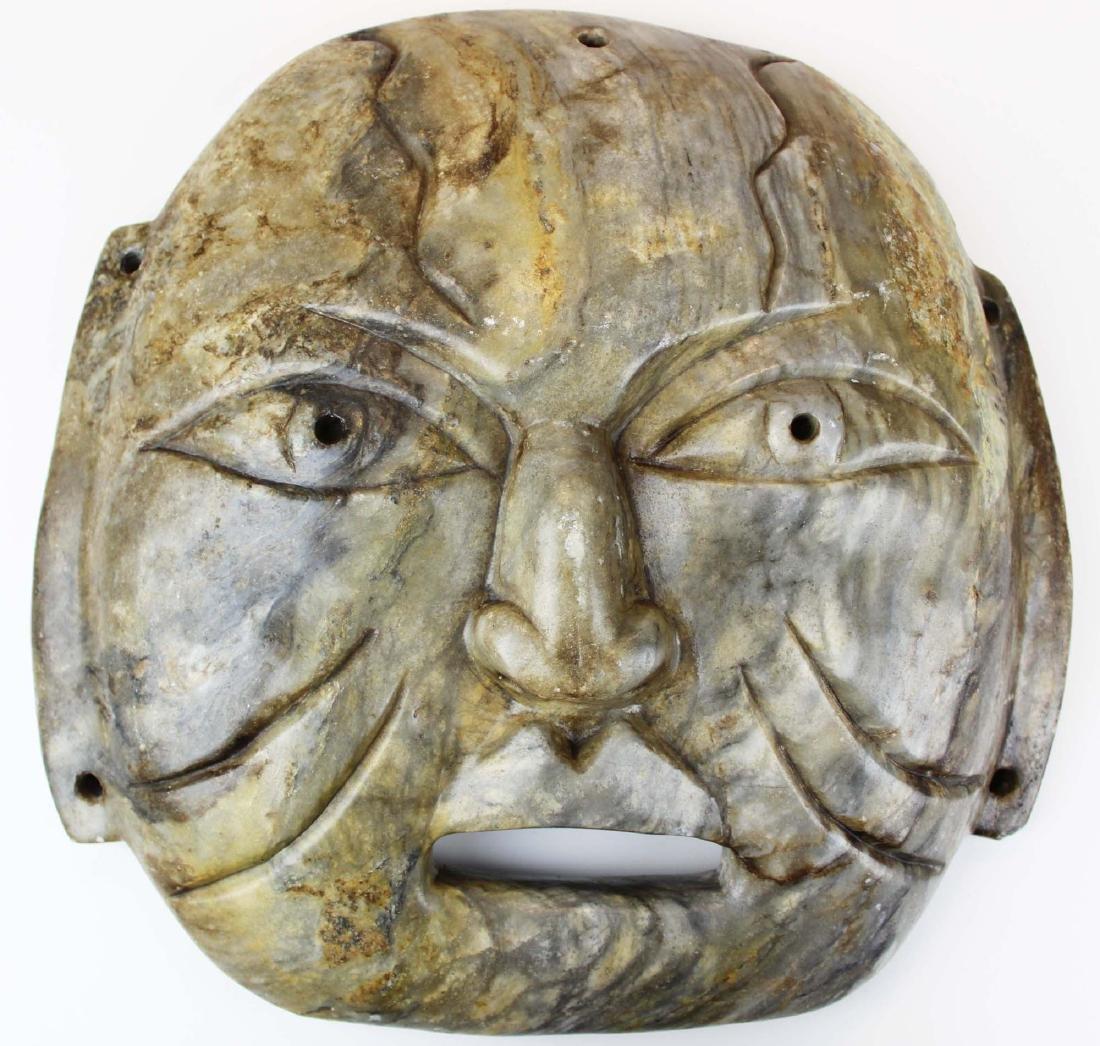 Olmec carved stone were-jaguar mask