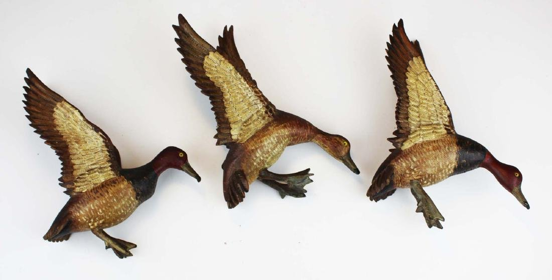 Group of 3 minature carved flying Canvasbacks