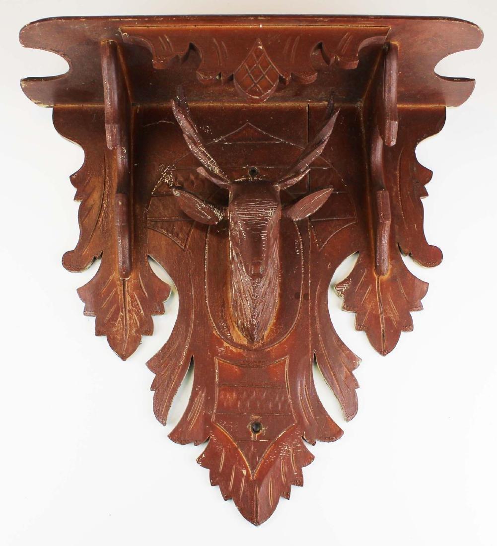Victorian black walnut stag carved clock shelf