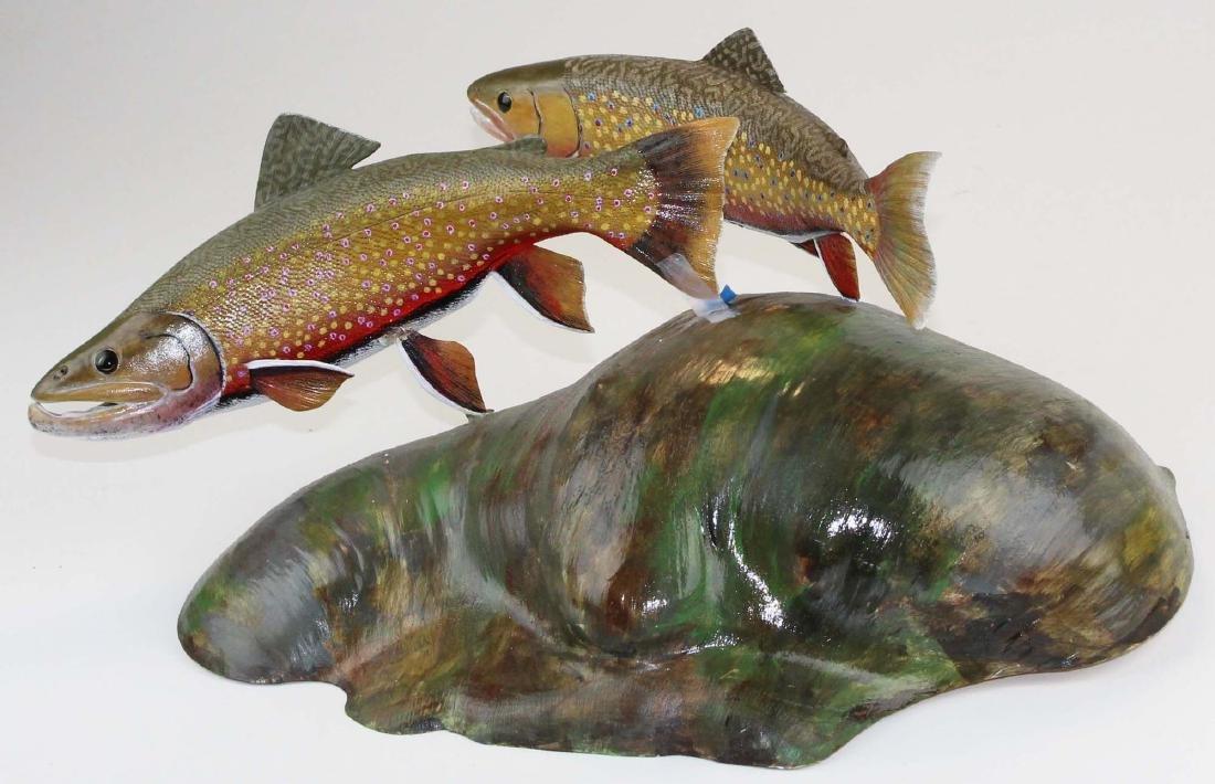 Albert Diem carving of two swimming brook trout