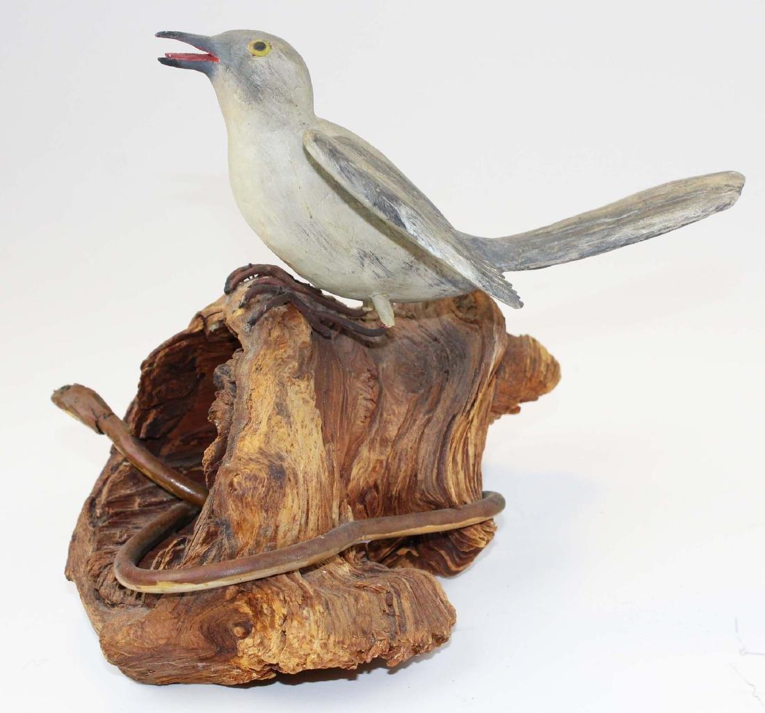 Folk art carved bird & snake signed L Beckstead