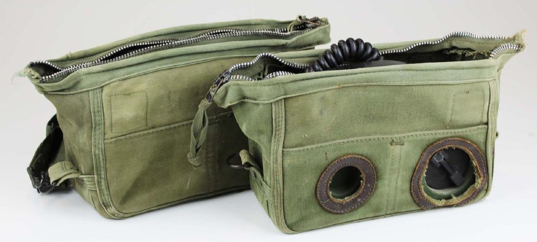 two US Army telephones with cases