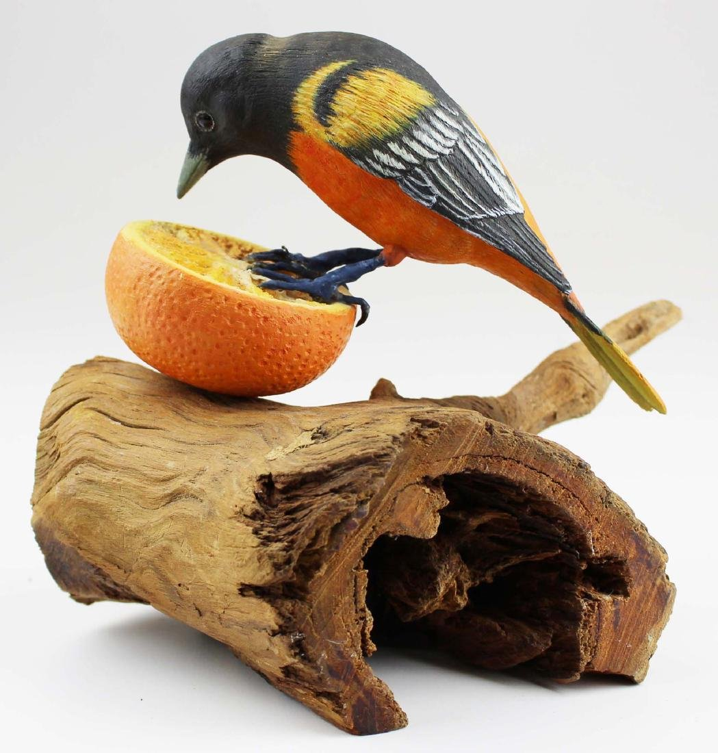 Carved & painted Oriole on an orange