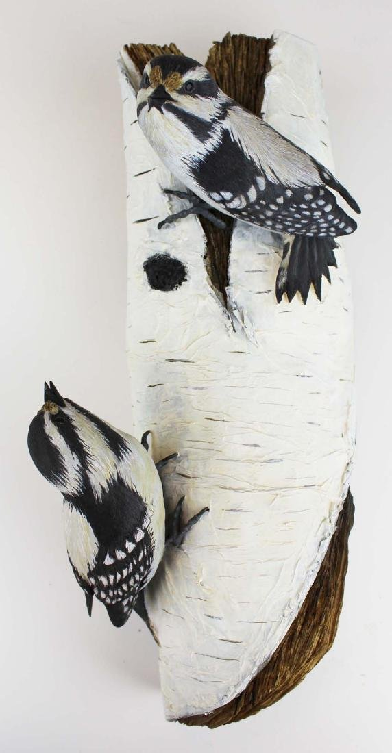 Two carved & painted song birds on birch log