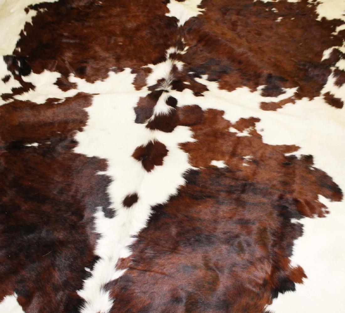 Western steer hide suede and fur area rug