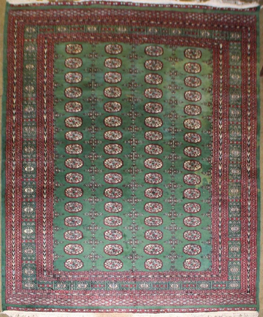 20th c. Pakistan Bokhara room size wool carpet