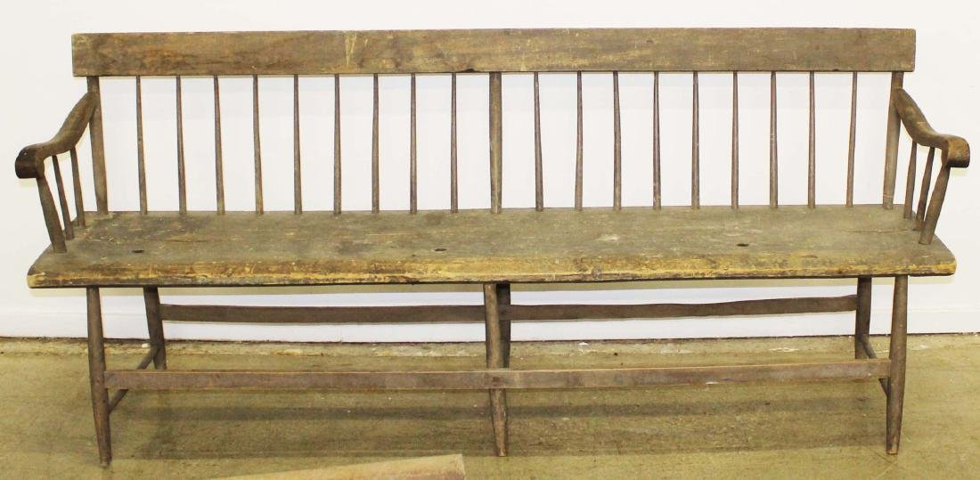 Country deacons bench in old gray paint