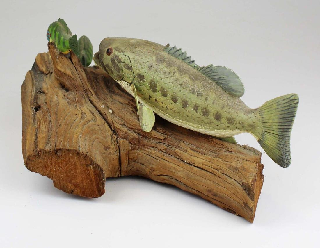 Rupert King Jr carving of bass chasing sunfish. - 4