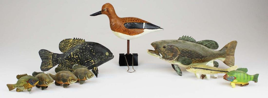 Group of small fish and bird carvings by R King Jr.