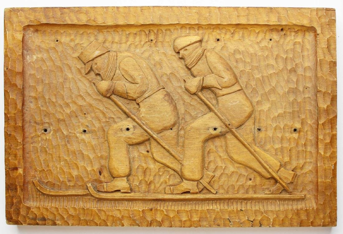 folky carved plaque with cross country skiers