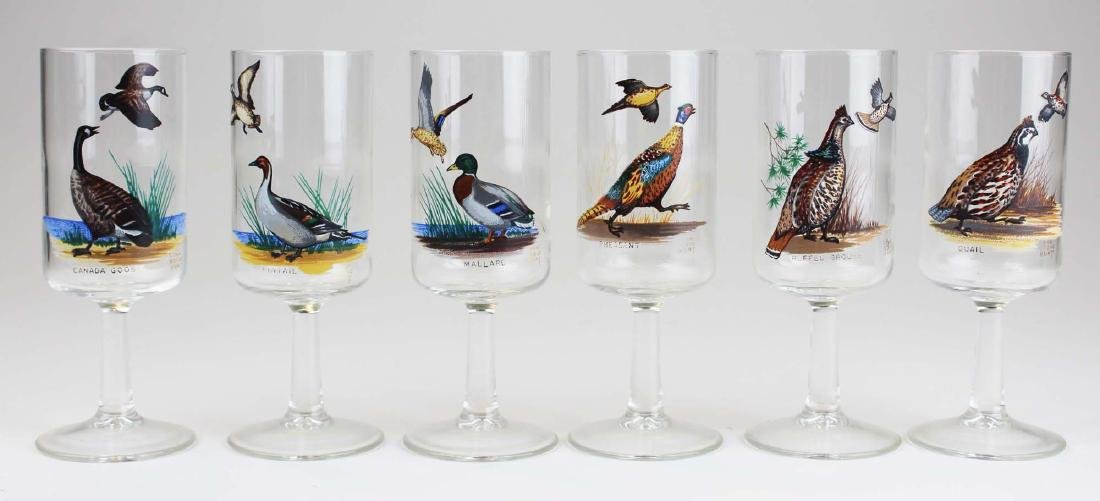 13 stemmed glasses with game birds