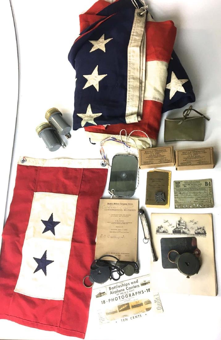 A group of WW II accessories and flags