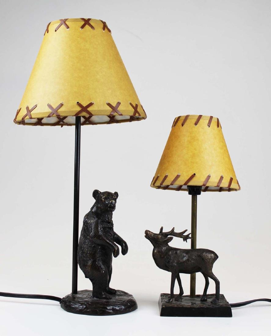 Two bronze base Adirondack style table lamps