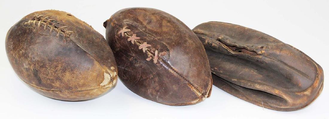 three vintage pigskin footballs