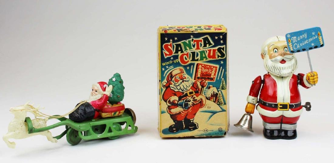2 1950's Japanese wind-up Santa Claus toys