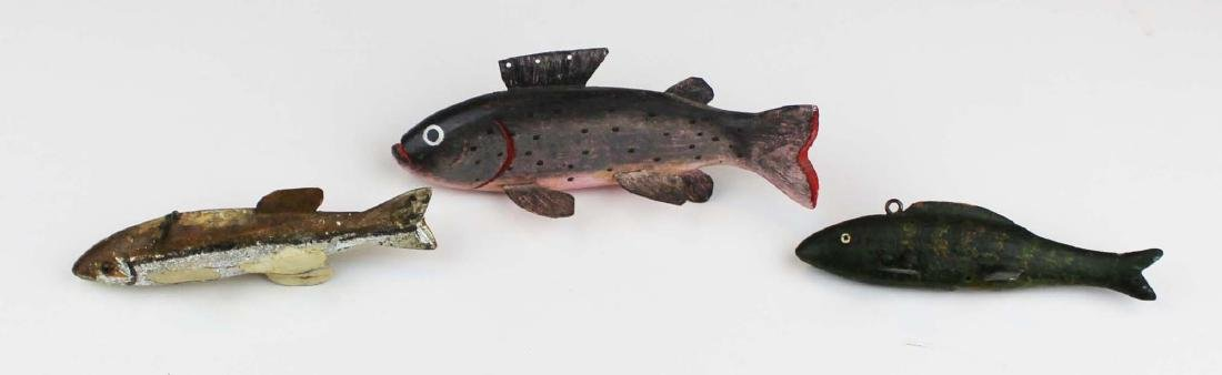 three wooden fish decoys