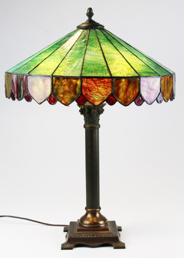 unsigned brass table lamp with leaded shade