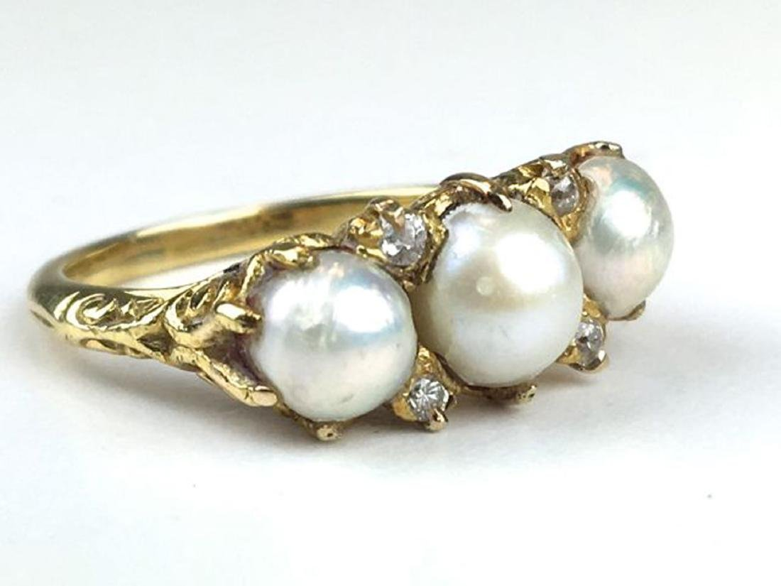 Diamond, pearl, & 18k yellow gold ring.