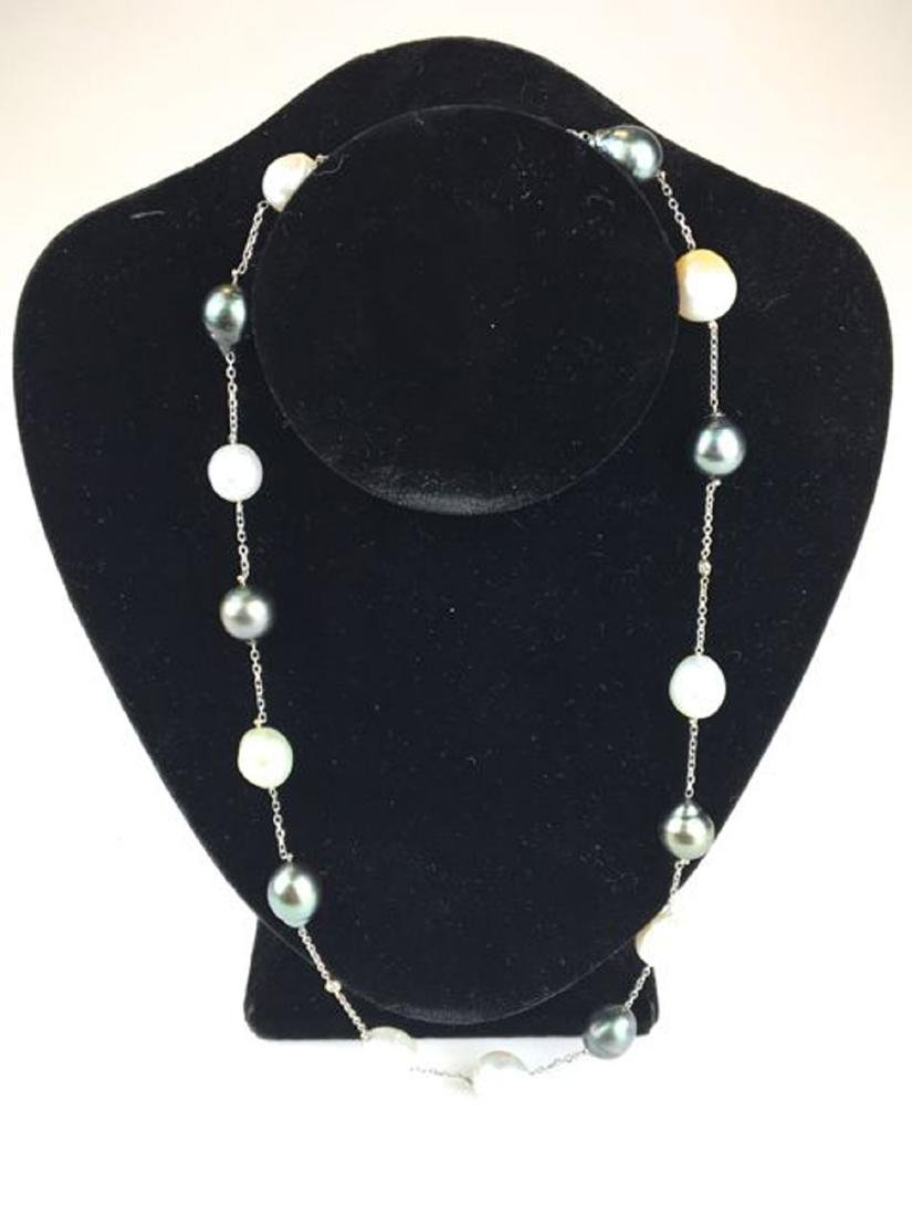 Black & white pearl and diamond necklace.